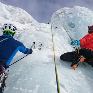 ice climbing gear on an icy cliff
