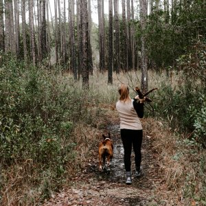 girl hiking with her dog