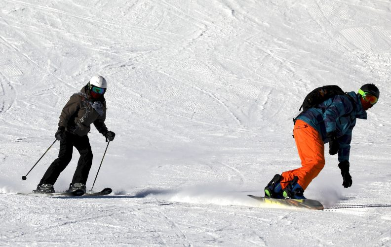The Real Differences Between Skiing and Snowboarding
